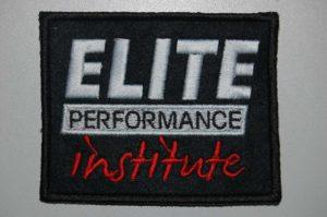 Logo firmy Elite Perfrmance institute na naszywce