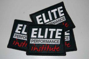 Prostokątne naszywki z haftem logo Elite Performance Institute